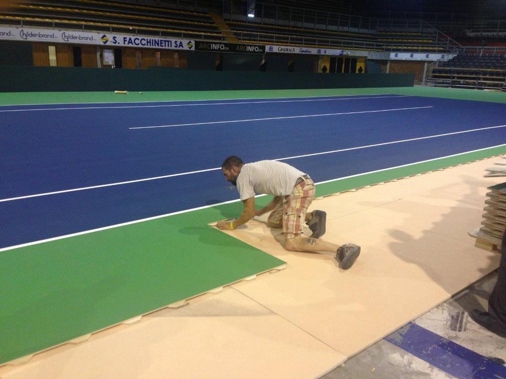 Portable tennis surface for davis cup california sports for Sports flooring